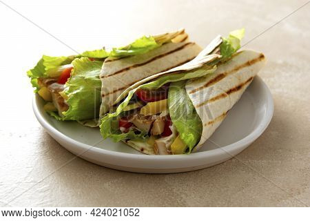 Wrap Burrito Sandwich Or Kebab With Flatbread With Vegetables And White Meat. Delicious Healthy Food