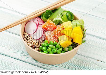 Poke bowl with salmon, cucumber and mango. Traditional hawaiian meal