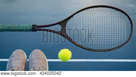 Composition of tennis ball, sports shoes and racket on tennis court. sports and competition concept digitally generated image.