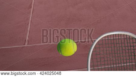 Composition of tennis ball and racket on tennis court. sports and competition concept digitally generated image.