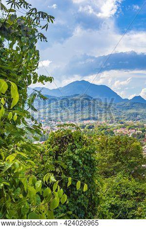 Luang Prabang City In Laos Landscape Panorama With Mountain Range.