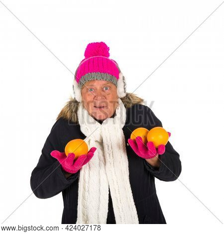 Healthy winter woman with fruit isolated over white background