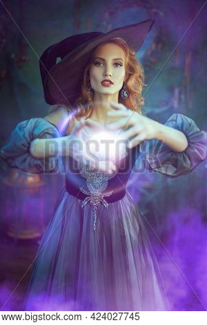 Halloween magic. Dark and beautiful witch conjures in the old castle on Halloween night. Fairy tales.