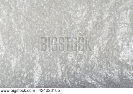 Bubble Wrap Protective Packaging On White Background. The Texture Of The Plastic Wrap. Top View.
