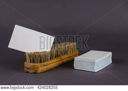 Garment Cleaning Brush And Stack Of Blank Business Cards On Gray Background. White Rectangular Busin