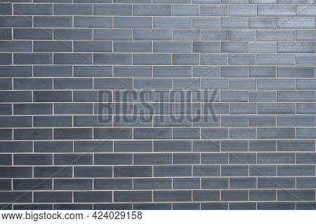 Background From A Wall Made Of Gray Clinker Bricks