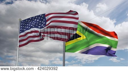 American and south african flag waving against clouds in blue sky. international relations and affairs concept