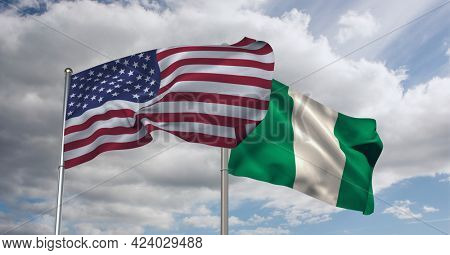 American and nigerian flag waving against clouds in blue sky. international relations and affairs concept