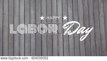 Happy labor day text and stars against wooden background. american labor day template background design concept