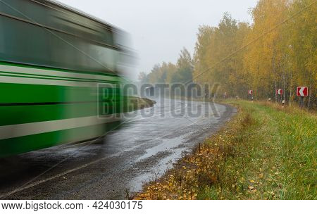 Autumnal Landscape With Highway , Rain, Mist And Blurred Transportation