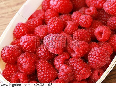 Berry background. Raspberry close-up. Excellent breakfast for a healthy diet.