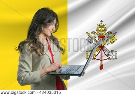 Freelance In Vatican. Beautiful Young Woman Freelancer Uses Laptop Computer Against The Background O