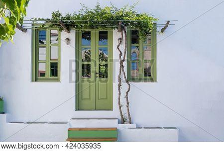 Folegandros Island, Greece, Cyclades. Whitewashed Wall With Flowering Jasmine