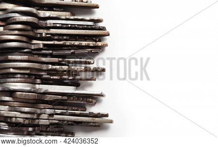 Many old brass and chrome keys isolated on white with copyspace. Security and encryption, concept image.