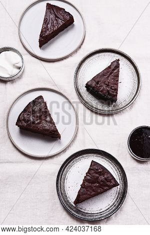 Slices Of Rich Moist Chocolate Cherry Cake. Homemade Dark Chocolate Sweet Brownies Cakes With Ice Cr