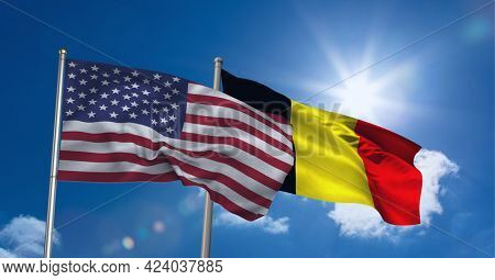 American and german flag waving against clouds in blue sky. international relations and affairs concept