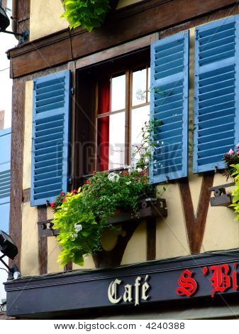 Window Over  French Cafe In Alsace