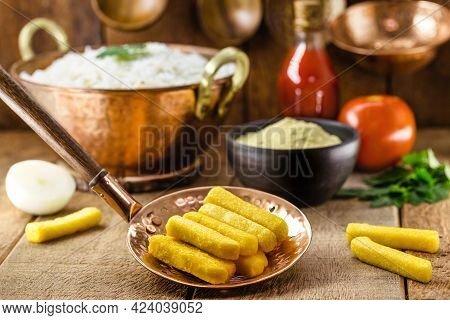Brazilian Cuisine, Called Polenta, Traditional Brazilian Fries, With Cornmeal And Sauce In The Backg