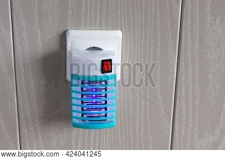 Included Working Fumigator Electric In Socket In Wall To Protect Against Mosquitoes, Close-up With C