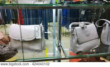 Fashionable Women's Handbags In Light Gray Color On Shop Window. Clothing And Accessories Fashion Bo
