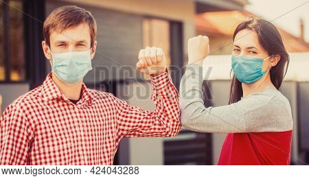 Elbows Bump. Friends In Protective Medical Mask On His Face Greet Their Elbows In Quarantine