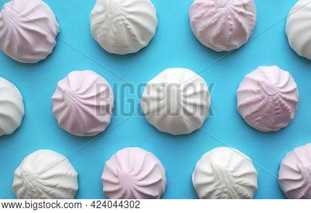 Background Made Of White And Pink Zephyr. Popular Russian Dessert Zefir Pattern.
