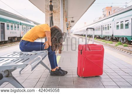 Black Woman Waiting For Delayed Train Arrival