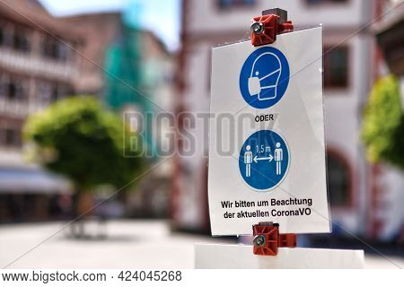 Mosbach, Germany - June 2021: Signs For Face Mask And Distance Requirement In German City With Text