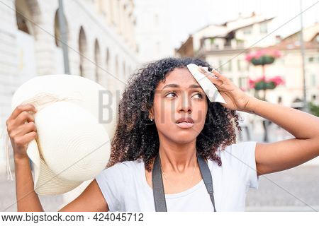 Afro Woman Stressed By Heatwave Summer In The City
