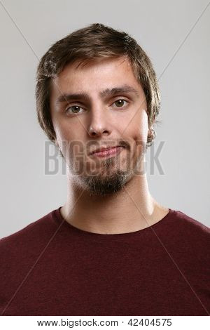 Portrait of young man with boring expression  isolated over background