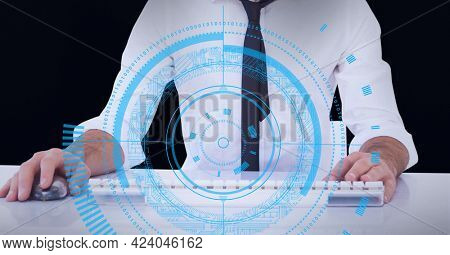 Round scanner against mid section of man using computer against black background. global business and technology concept