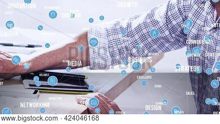 Network of digital icons and business concept texts against mid section of person using computer. global networking and business technology concept