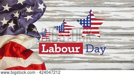 Happy labor day text and stars against american flag on wooden background. american labor day template background design concept