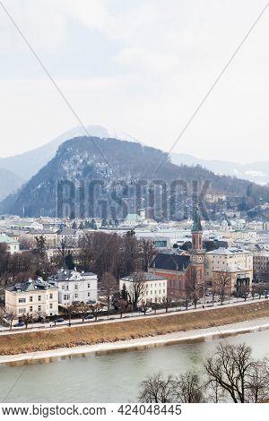 Salzburg Skyline.  A Winter View Across The Salzach River And Salzburg Skyline In Austria.  In The B