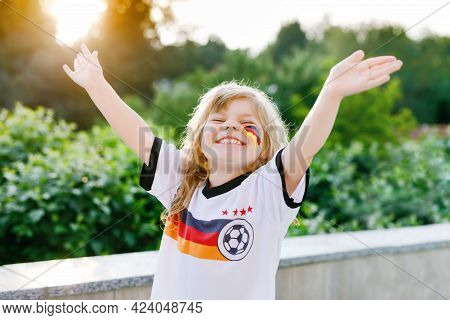 Little Blond Preschool Girl Watching Soccer Football Cup Game On Public Viewing. Happy Joyful Excite