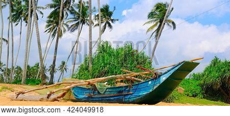 Untouched Tropical Beach With Palms And Fishing Boats In Sri-lanka. Wide Photo.