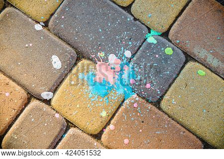 Colored Blot Of Paint On Paving Slabs. Yellow Paving Stones