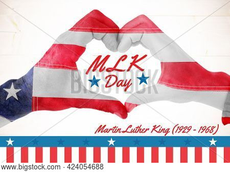 Composition of m l k day text, with american flag decorated hands making heart shape, on white. martin luther king day celebration poster design template concept digitally generated image.