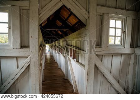 Wonderful Covered Wooden Bridge By Dusan Jurkovic In Garden, Arcade, White Walls With Small Windows,