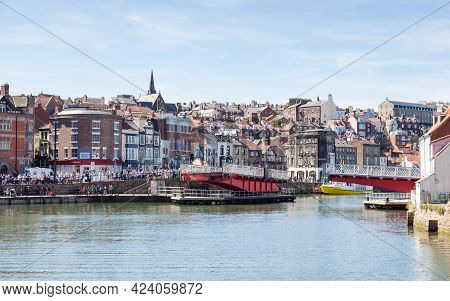 Whitby, England - June 25:  The View Across The River Esk Towards The Swing Bridge In The Seaside To