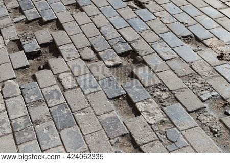 Old Damaged Cobbled Road, Concrete Street Pavement, Abstract Background Photo