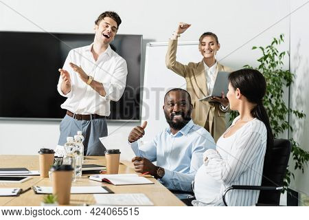 Happy Business People Celebrating Triumph In Conference Room