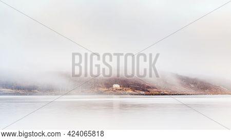 Kirkenes Coastline.  A Home Shrouded In Mist Viewed From The Kirkenes Coastline.  Kirkenes Is A Town
