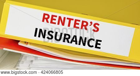 Renters Insurance Policy On A Binder On A Table