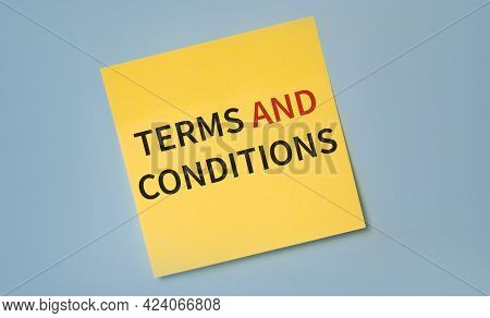 Terms And Conditions. Text On Bright Yellow Sticker Against Blue Background.