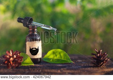 Natural Beard Oil, Brown Bottle. Cosmetic For Beard Or Aromatherapy In Glass Bottle Copy Space.