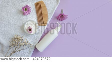 Shampoo, Wooden Comb Flower On A Colored Background