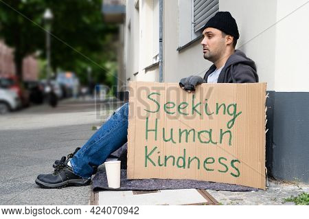 Homeless Lonely Poor Man With Cardboard Seeking Kindness
