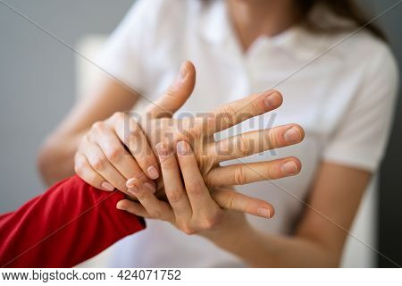 Reflexology Hand Massage And Physiotherapy. Elder Man Having Acupressure Therapy