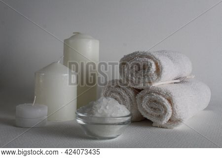 Spa Salon Towels Slide Candle Salt Oil On A White Background With Room For Insertion. A Copyspace. H